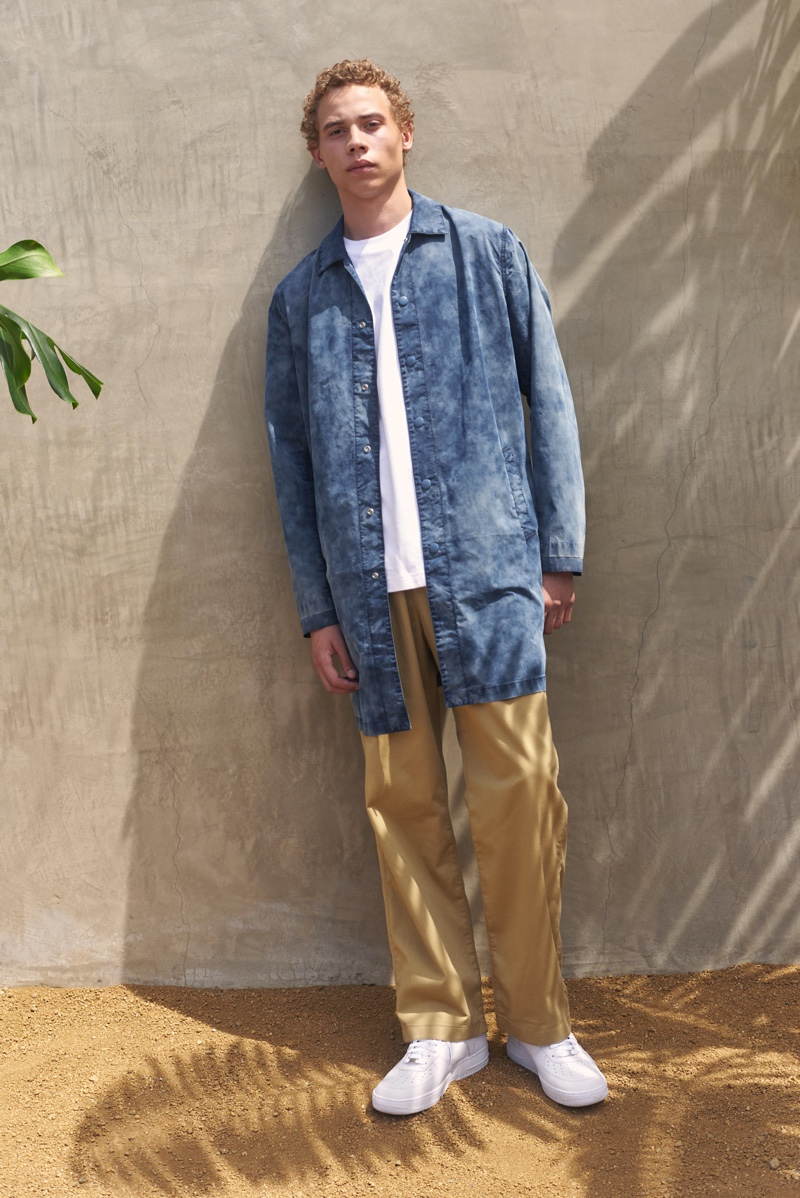 Front and center, Lye-Amone Cassac models a drop shoulder mackintosh with relaxed chinos from Levi's Made & Crafted.