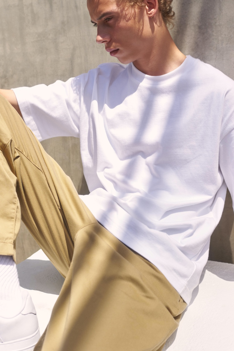 Sporting an oversized tee, Lye-Amone Cassac also wears Levi's Made & Crafted's relaxed chinos.