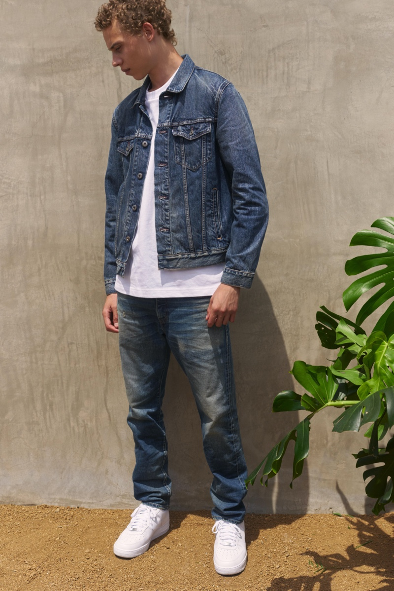 Doubling down on denim, Lye-Amone Cassac wears Levi's Made & Crafted.