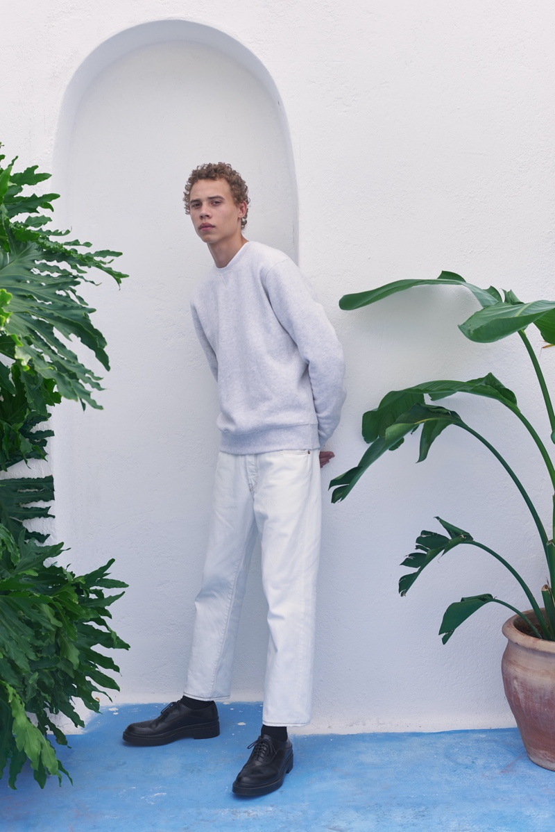 Making a case for light hues, Lye-Amone Cassac dons a sweatshirt and jeans from Levi's Made & Crafted.
