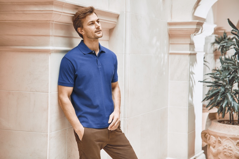 Connecting with Luca Faloni for spring-summer 2020, Craig Le Roux wears one of the brand's polo shirts in royal blue.