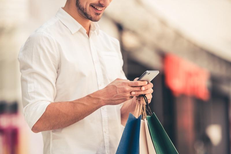 Man Smiling Phone Shopping Bags