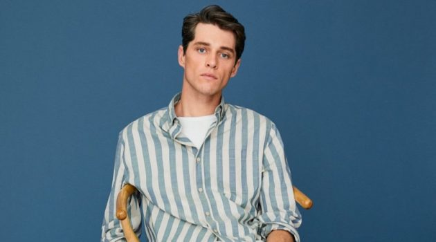 Luke Powell models a striped cotton shirt with regular fit jeans from Mango.