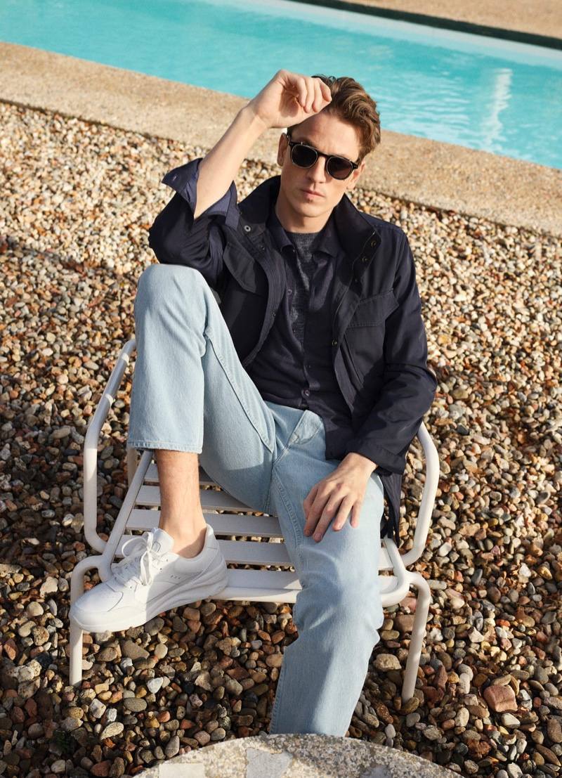 Relaxing poolside, Hugo Sauzay wears Mango's regular fit Bob jeans with a field jacket.