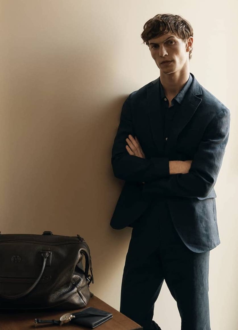 French model Luc Defont-Saviard dons a linen suit from Massimo Dutti.