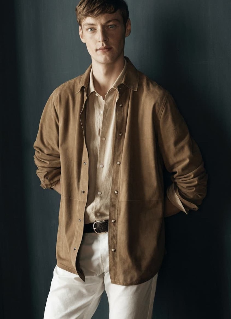 Front and center, Roberto Sipos models linen shirting with denim jeans by Massimo Dutti.