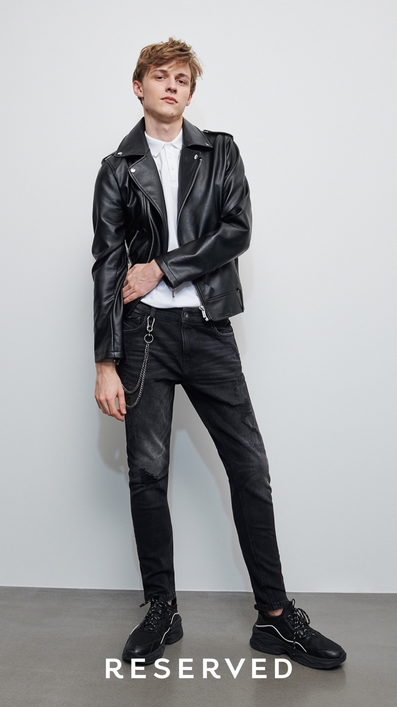 A cool vision in Reserved, Max Barczak rocks a biker jacket with black jeans, a wallet chain, and white shirt.