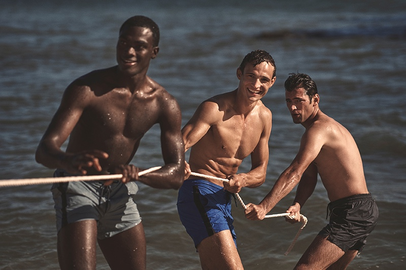 Playing a game of tug of war, Davidson Obennebo, Julian Schneyder, and Sean O'Pry front Orlebar Brown's spring-summer 2020 campaign.
