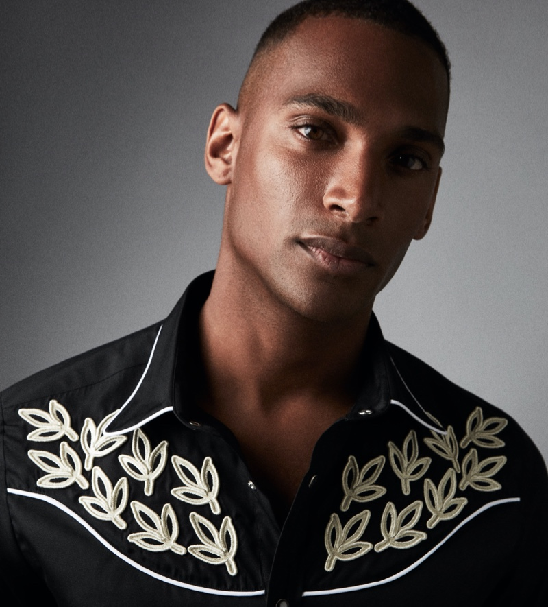 Patrick Nodanche sports a black Caprice embroidered western shirt from Reiss' Americana collection.