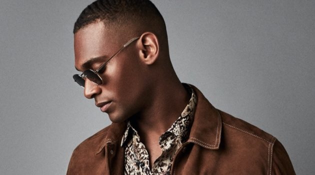 Embracing western style, Patrick Nodanche models a brown suede Hurst jacket from Reiss. He also rocks the brand's Adder snake print shirt with its Etna jeans and Rio sunglasses.