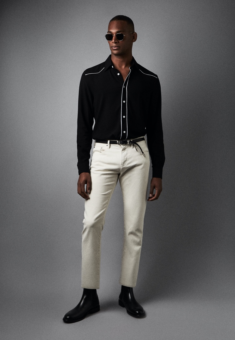 Front and center, Patrick Nodanche wears Reiss' Mayvis western shirt in black with Etna jeans and Tenor boots.