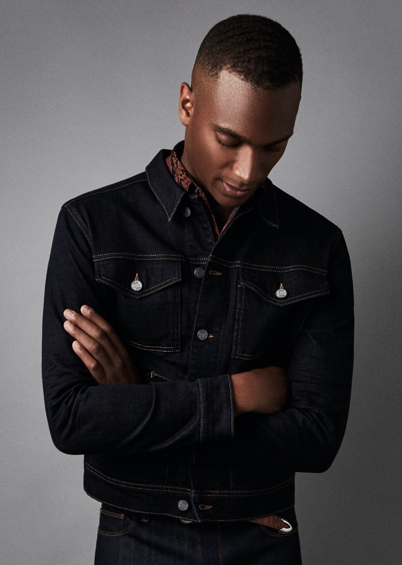 Model Patrick Nodanche rocks Reiss' four-pocket Chester denim jacket in indigo.