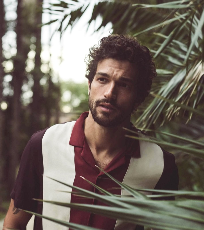 Embracing tropical style for summer, Paul Kelly models a color-block shirt by Scotch & Soda.