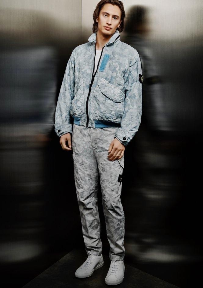 James Turlington rocks Stone Island's Big Loom Camo-TC jacket with cargo pants for Holt Renfrew.