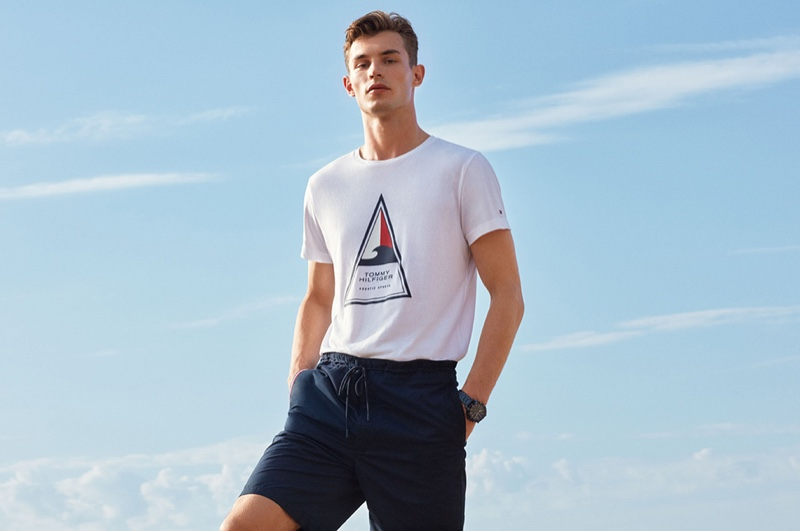 Taking to the beach, Kit Butler wears a Tommy Hilfiger look that features the brand's Bio Cool and Coolmax fabrics.
