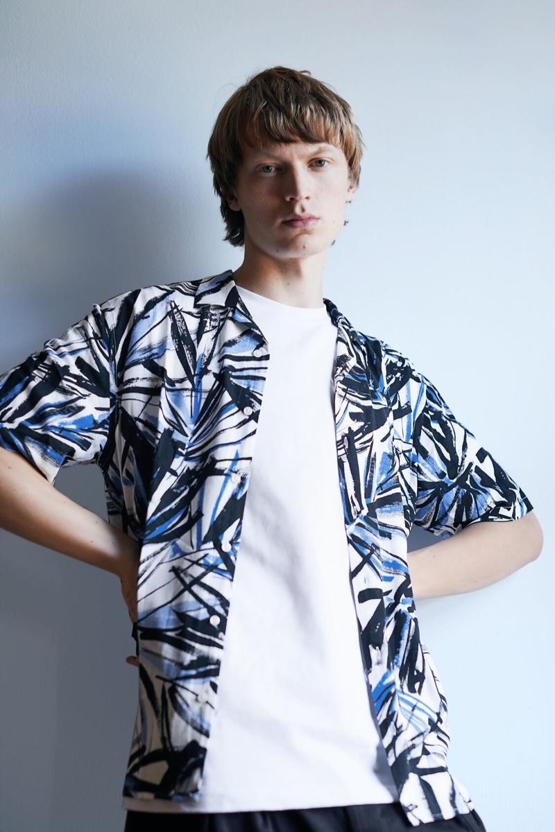 Ready for summer, Jonas Glöer models a tropical print short-sleeve shirt from Zara.