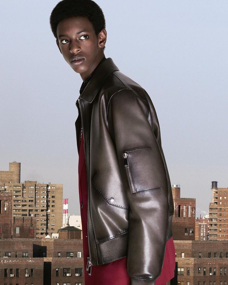 Craig Shimirimana stands out in a leather jacket from Berluti's pre-fall 2020 collection.