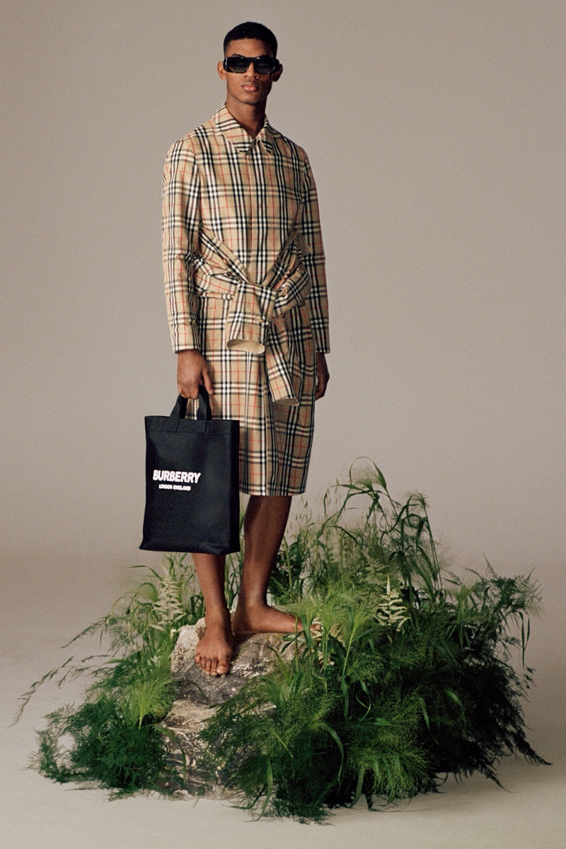 Donning Burberry's famous check, model Reece Nelson takes hold of the brand's logo print ECONYL tote.