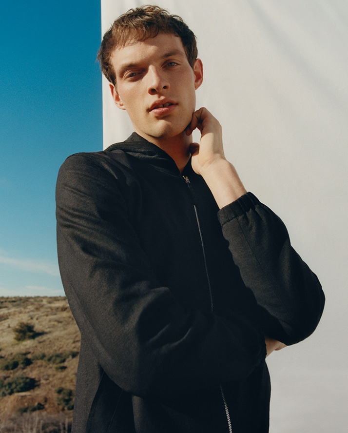 Ready for summer, Rocky Harwood dons a linen bomber by Club Monaco.