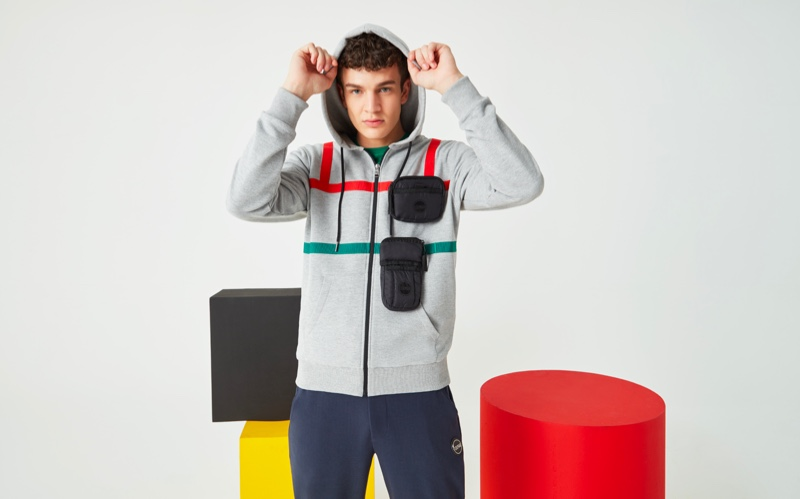 Embracing casual style, Aghiles Dahmani models a Research hoodie from Colmar's spring-summer 2020 collection.