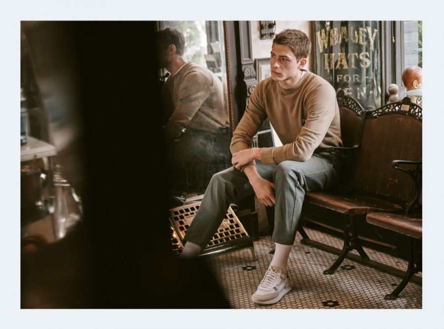 Model Paul Fontanier dons a crewneck sweatshirt and tapered pants by Maison Kitsune for East Dane.