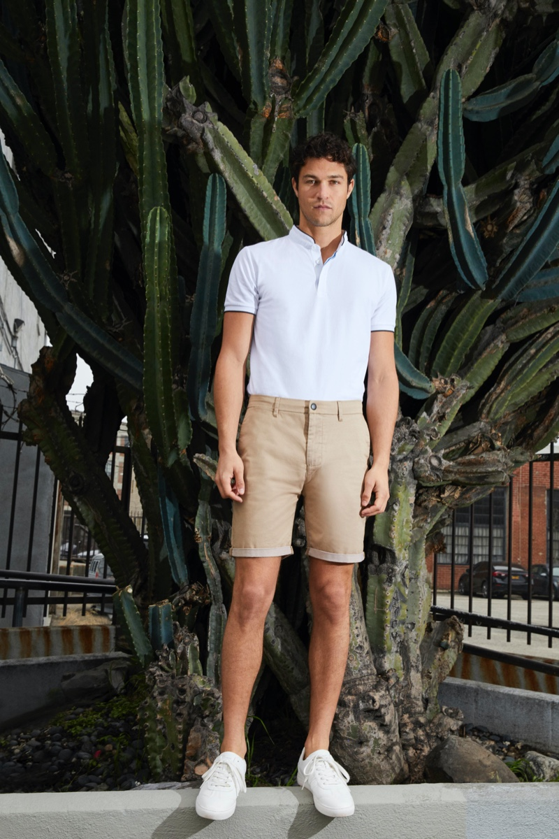 Front and center, Miles McMillan is a smart vision in a polo shirt and shorts by Esprit.