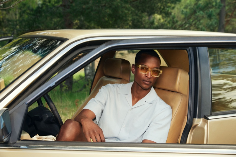 Getting into a vintage car, Oliver Kumbi models sunglasses from the H&M x CHIMI collaboration.