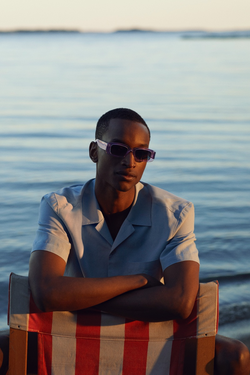 Oliver Kumbi sports stylish sunglasses from the H&M x CHIMI collaboration.