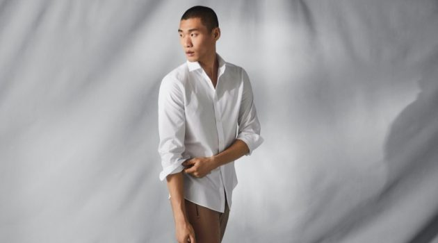 Kamui Tanaka dons a crisp white shirt that uses H&M's Coolmax fabric technology.