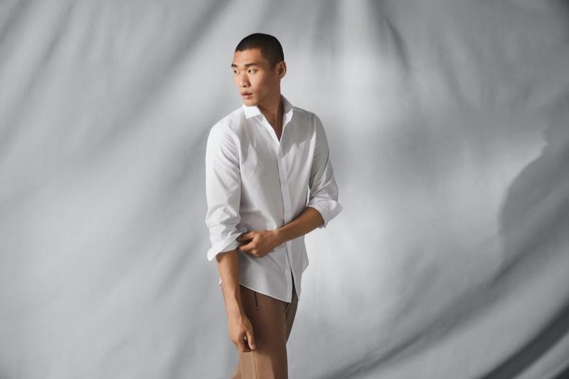 Kamui Tanaka dons a crisp white shirt that uses H&M's Coolmax fabric technology.