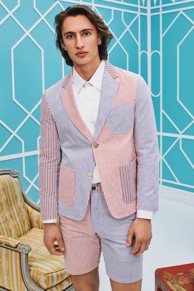 Model James Turlington dons a Thom Browne seersucker jacket and shorts for Holt Renfrew.