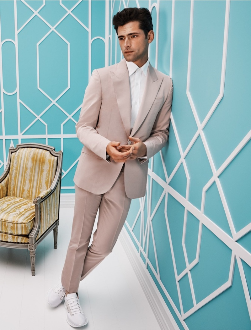 Front and center, Sean O'Pry wears a Givenchy suit with knitted sneakers from Holt Renfrew.