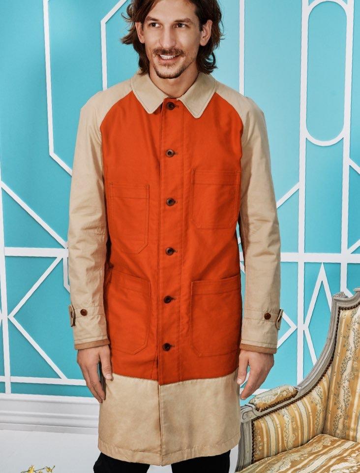 All smiles, Jarrod Scott models a long coat by Junya Watanabe from Holt Renfrew.