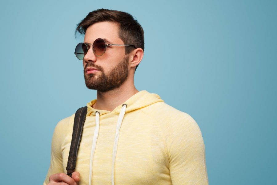 Man in Yellow Hoodie and Sunglasses