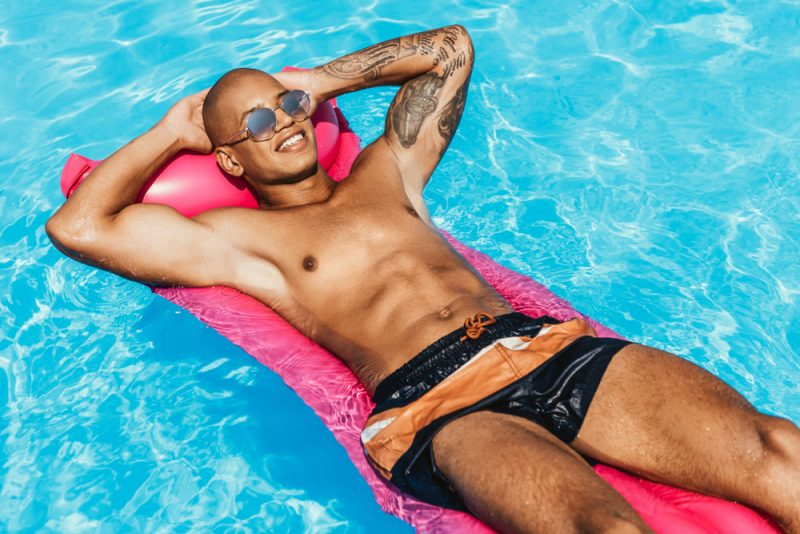 Man with Six-Pack Relaxing in Pool