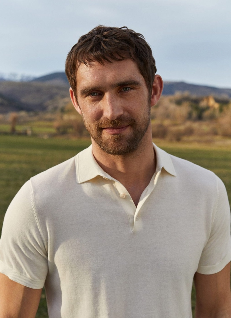 Will Chalker sports a knit cotton polo shirt by Mango.