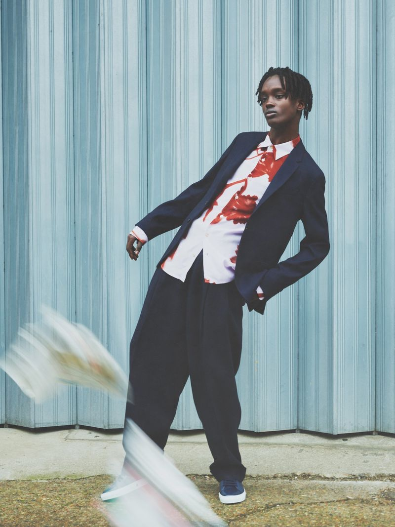 Mo M'bengue dons relaxed summer tailoring by Paul Smith.