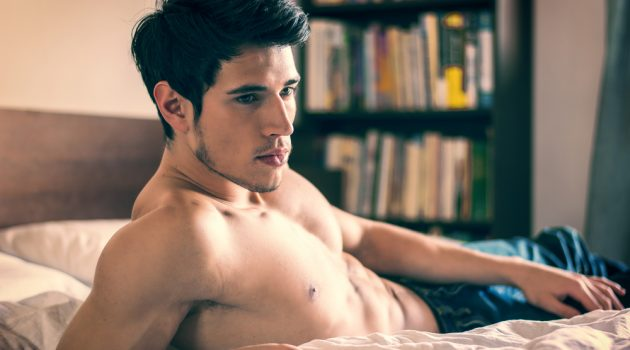 Shirtless Model in Bed