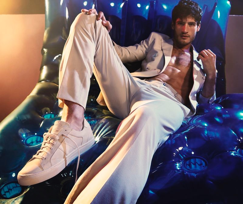 Donning an off-white look, Ryan Tift sports a pair of sneakers for Steve Madden's summer 2020 campaign.