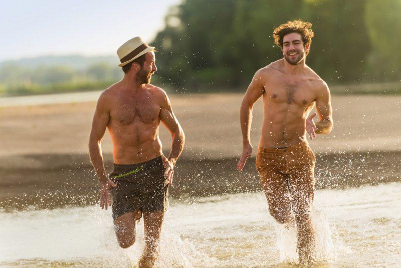 Two Men Running at Beach