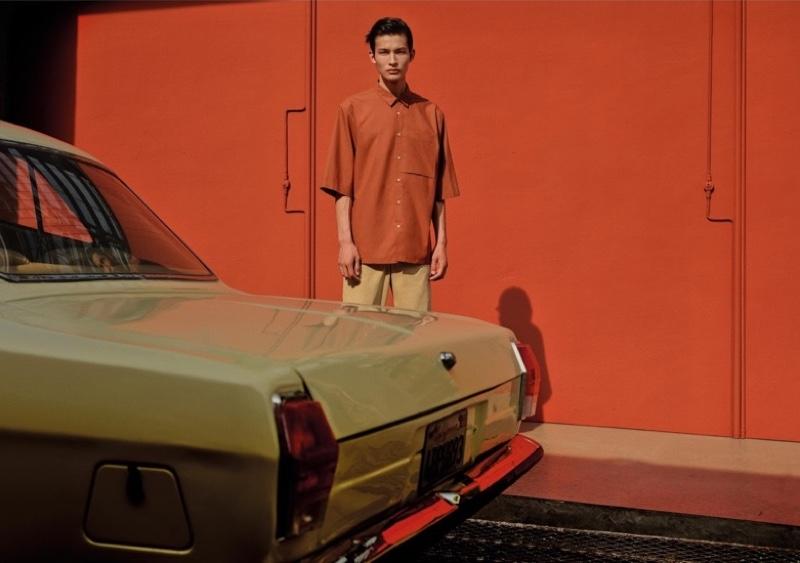Embracing summer style, Huang Shixin models a short-sleeve shirt with textured chino pants by Zara.