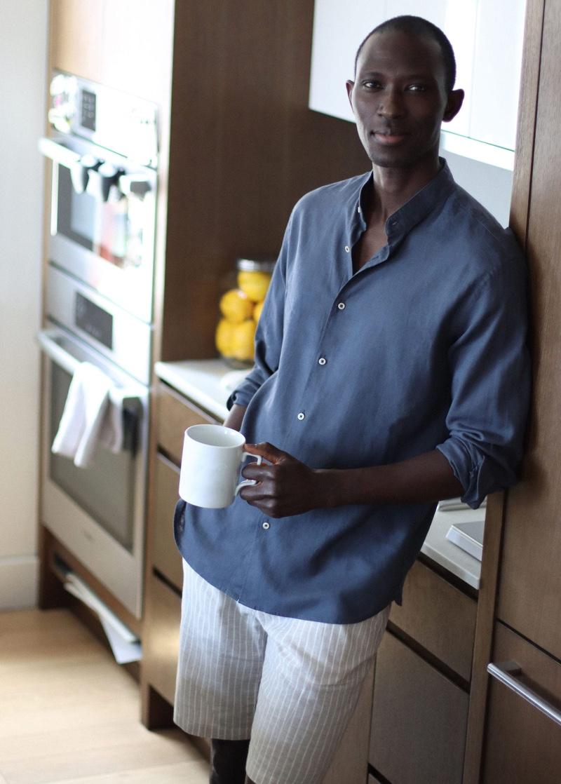 Model Armando Cabral sports Mango's printed linen-cotton blend Bermuda shorts with a regular-fit linen shirt.