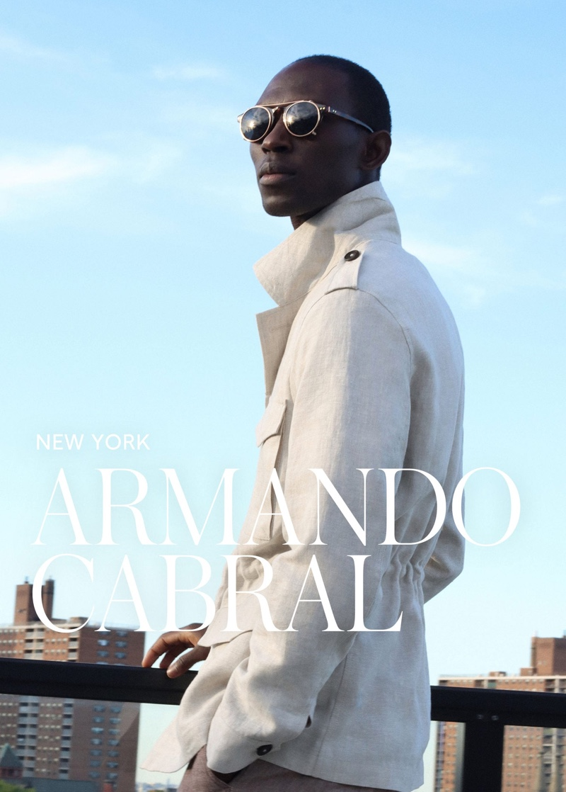 Donning a sleek linen coat, Armando Cabral also wears Mango's clip-on lens sunglasses.