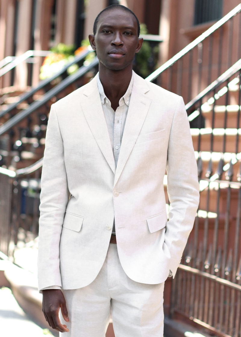 Embracing Mango's Committed line, Armando Cabral models a slim-fit linen suit blazer and pants.