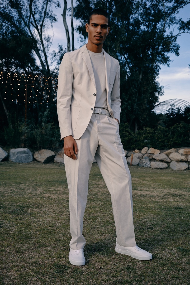 Geron McKinley makes a chic summer statement in a pale gray suit by BOSS.