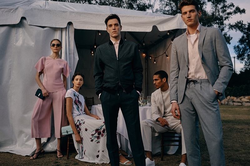 Models Josh Beech, Geron McKinley, and André Feulner sport summer tailoring from BOSS.