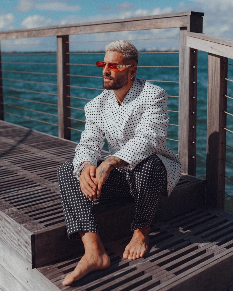 Maluma embraces Parisian style in a polka dot look for Balmain's resort 2021 campaign.