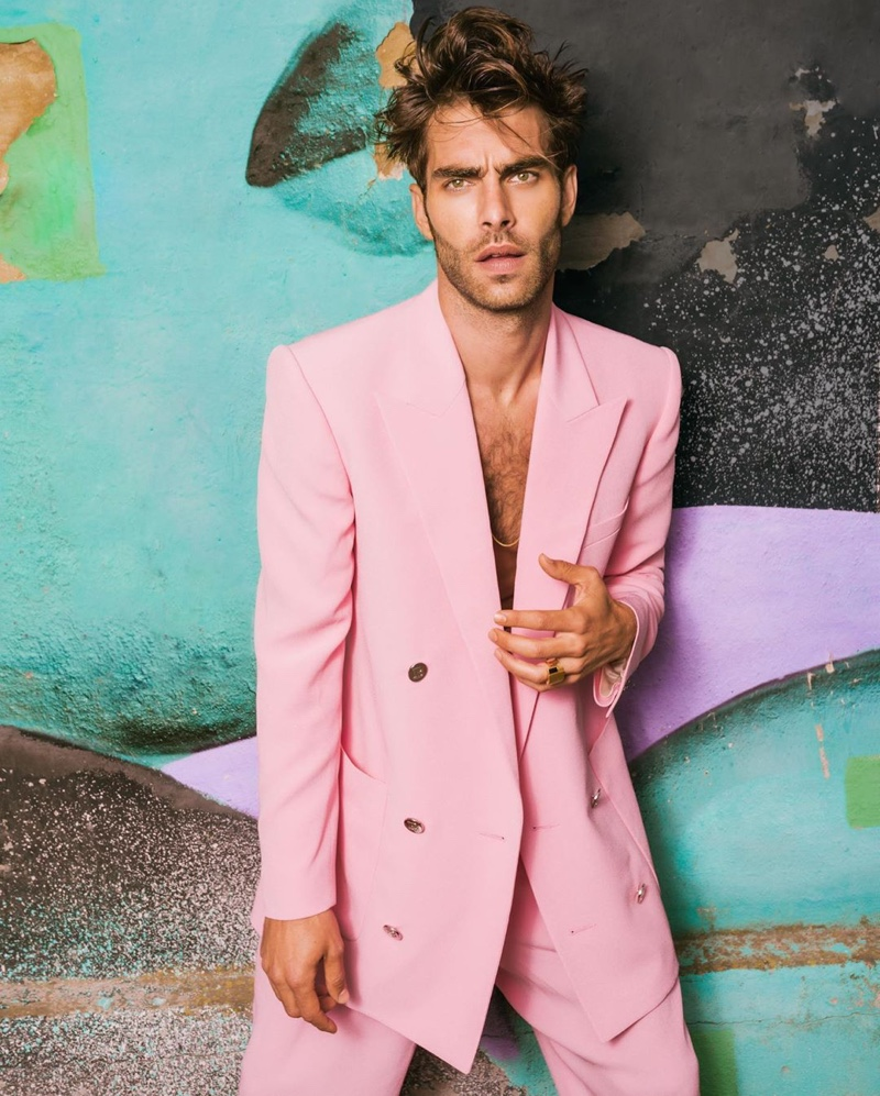 Jon Kortajarena channels Miami Vice style in a pink double-breasted suit for Balmain's resort 2021 campaign.