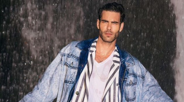 Miami Vice meets the Fresh Prince of Bel-Air as Jon Kortajarena dons a striped suit with a denim jacket for Balmain's resort 2021 campaign.