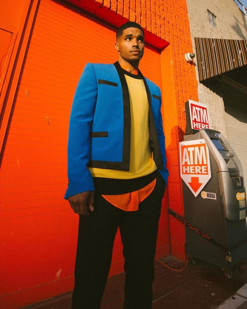 Rome Flynn makes a bold statement in a color-blocked look for Balmain's resort 2021 campaign.
